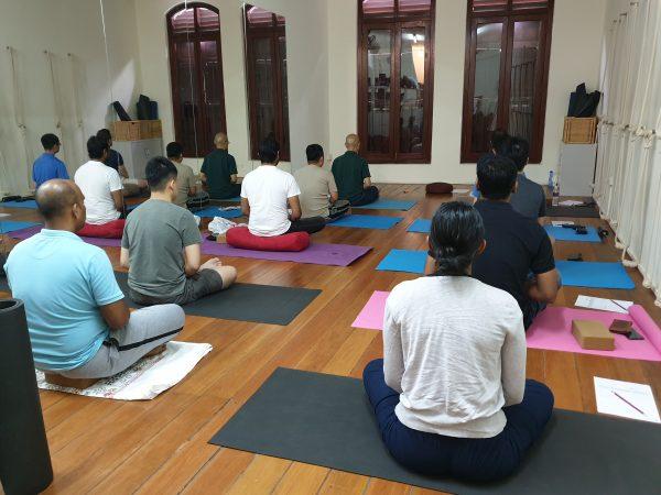A group meditating at meditation class - Xuan Healing Cove