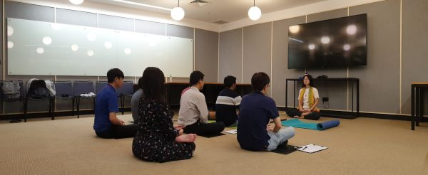 Multiple people meditating at a meditation class in WeWork - Xuan Healing Cove