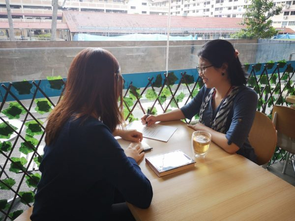 a client at a life coaching session with Xuan Healing Cove