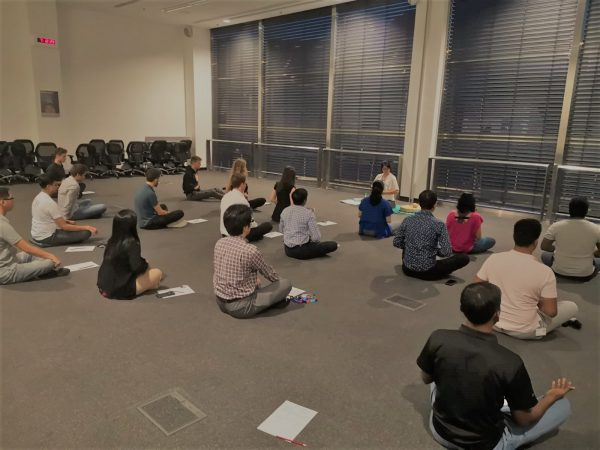 Multiple people meditating at a meditation class in Bosch - Xuan Healing Cove